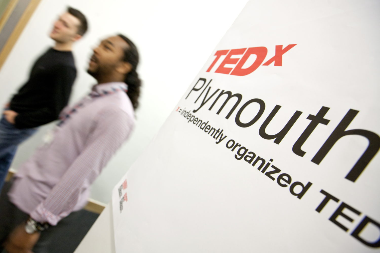 TEDxPlymouthUniversity sign and audience members