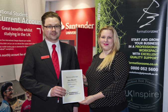 Lorna of L&D Training receiving her Business Challenge award from Stephen from Santander Universities